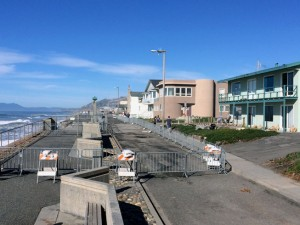 The cordoned-off area around the breach in the Beach Boardwalk seawall. There isn't much room to spare from seawall to front door. Note the sandbags along the front of the green house on the right.