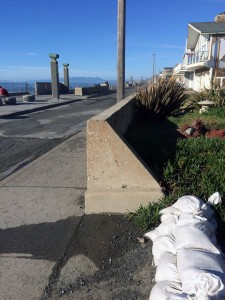 Sandbags guard the front yard of a home along the Beach Boardwalk in Pacifica.