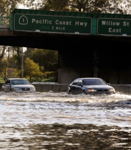 Cars make their way through the flooded north and southbound lanes of 710 Long Beach Freeway, the main artery to Long Beach and Los Angeles ports, on January 19, 2010 in Long Beach, California. A short but forceful storm moved through Southern California producing tornado-like winds in Huntington Beach and floods in Long Beach and San Pedro. (January 18, 2010 - Source: Kevork Djansezian/Getty Images North America)