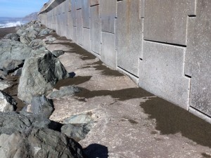 Concrete, poured over the riprap revetment at the base of the seawall, were bo111th in response to the severe damage to the wall caused by the El Niño of 1997-98.
